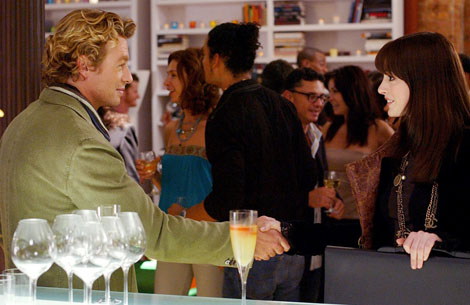 Simon Baker and Anne Hathaway